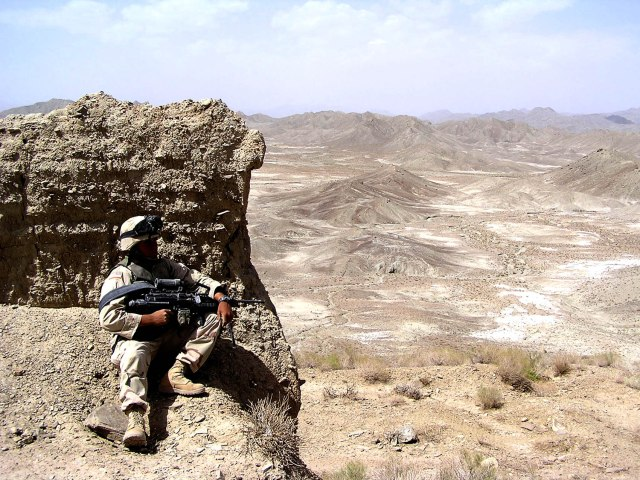 A 2nd Battalion, 27th Infantry Regiment Soldier provides overwatch on an Afghan valley during Operation Verendrye near the Afghan-Pakistan border.